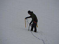 Matt Placing a Snow Picket During a Roped Travel Mountaineering Exercise