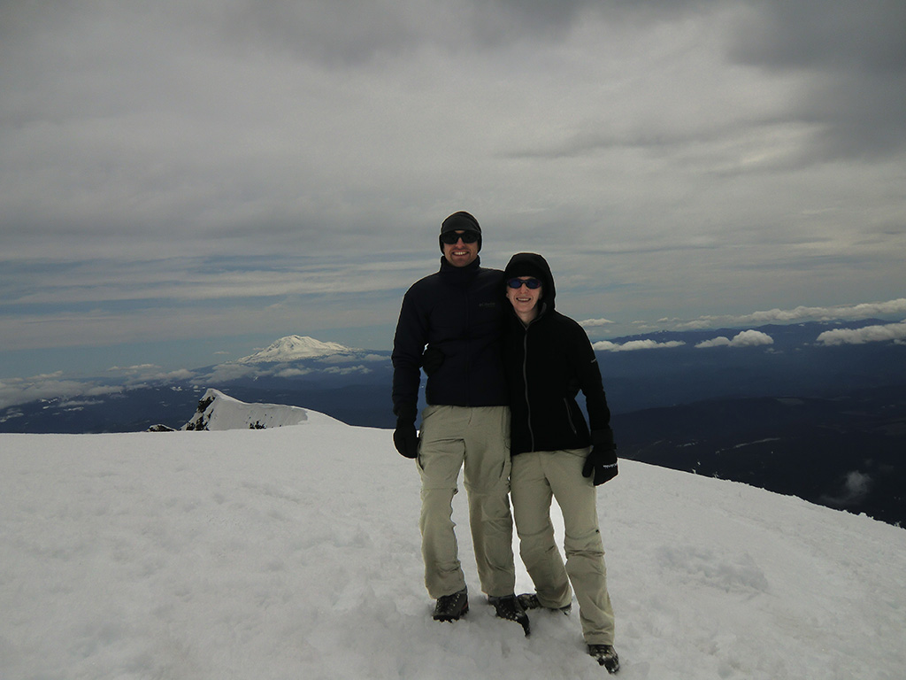 Katie and Jason on Summit Rim of Mount St. Helens with Mount Adams in the Background