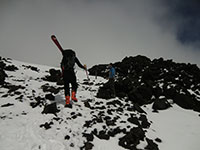 Carrying Skis Over Rocks