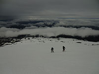 Matt and Louis Climbing up Mt Hood through the Cloud Layers