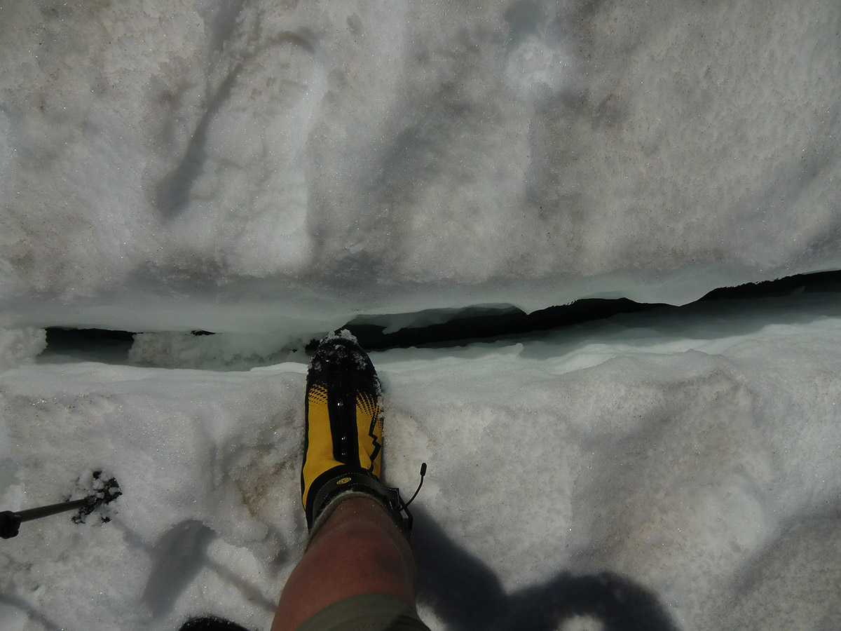 Walking Over a Crevasse on Emmons Glacier