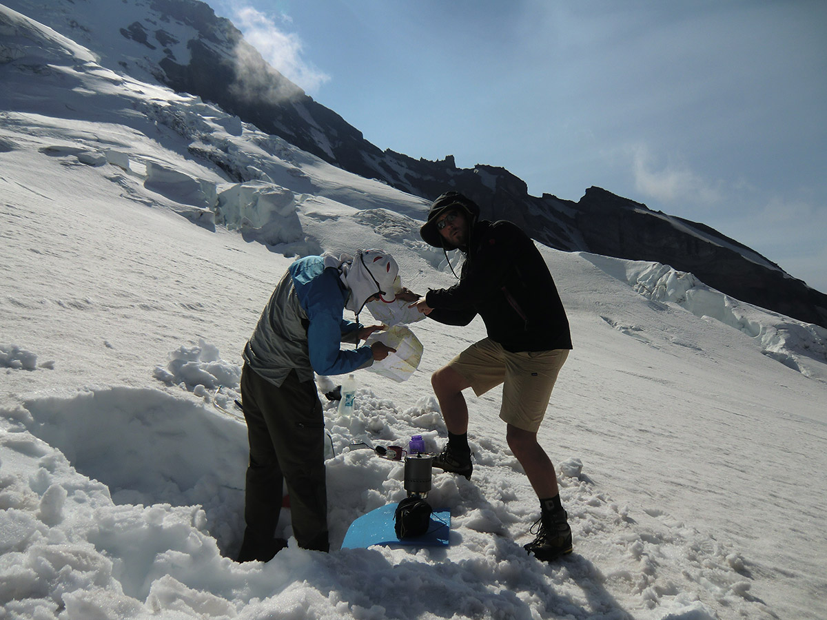 Matt and Louis Melting Snow and Analyzing Topo Maps at Camp