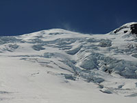 Mt Rainier with Spindrift Blowing in the Gale Force Winds Near the Summit