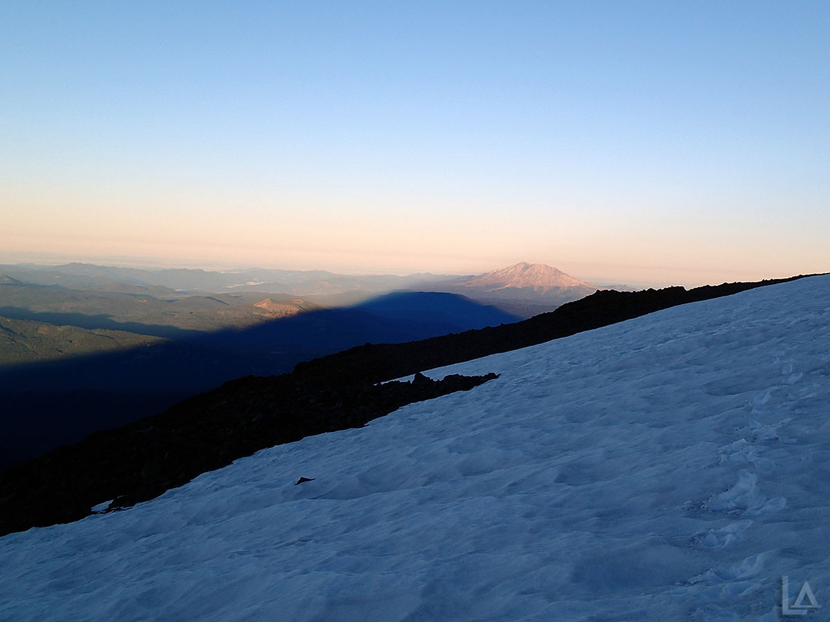 Shadow from Mt Adams at Sunrise with Mt Saint Helens in the Background