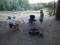 John and Katie Watching the Dutch Oven over our Campfire