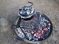 Cooking Cornbread in Dutch Oven over Campfire