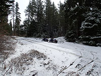 Snowmobiling on Almost Bare Road out of Snow King Sno-Park