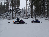 Snowmobiling at the Foot of the A.G. Aiken Lava Bed