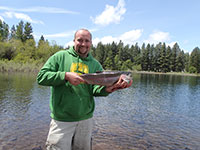 John with Freshly Caught Monster Rainbow Trout