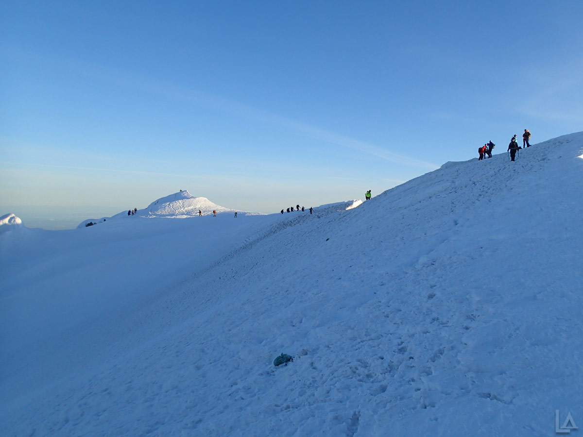 An Endless Line of Climbers on the Summit Ridge