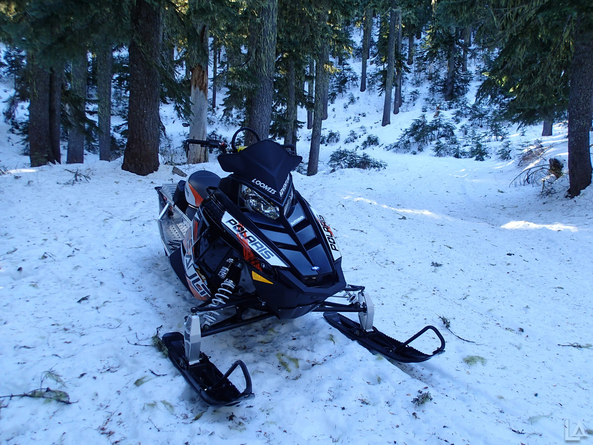 Frozen snowmobile ride to Camp Windy