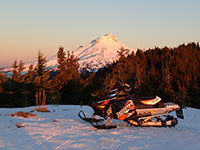Polaris Switchback Assault 800 at sunrise with Mt Hood in the background
