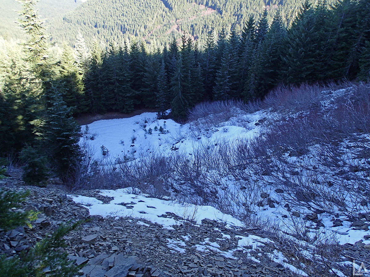 Looking down from Pechuck Mountain at some snow