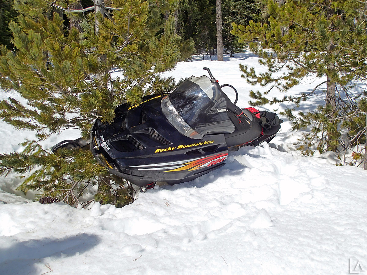 Mark's snowmobile hung up on a tree