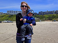 Katie and our Mini-Adventurer at a beach in Lincoln City