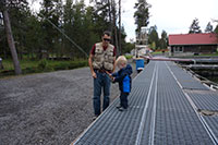 Teaching our Mini Adventurer how to hold a fly rod at Fall River fish hatchery