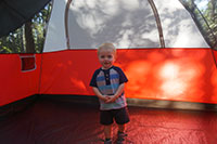 Julian playing in 'Uncle' John's tent