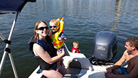 Katie and Julian and Jordan and Lincoln in our boat on the Willamette River