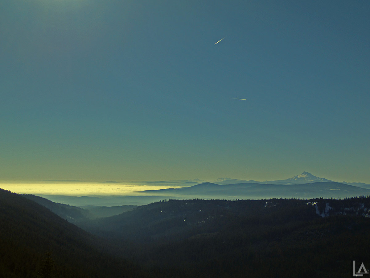 The Three Sisters and Mt Jefferson with fog in the lowlands
