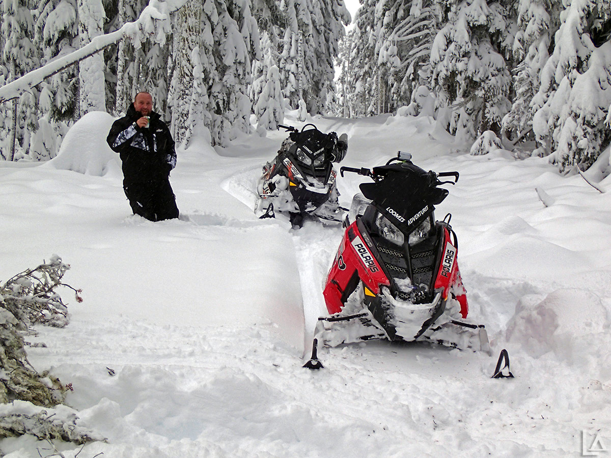 Snowmobiling in powder past our knees