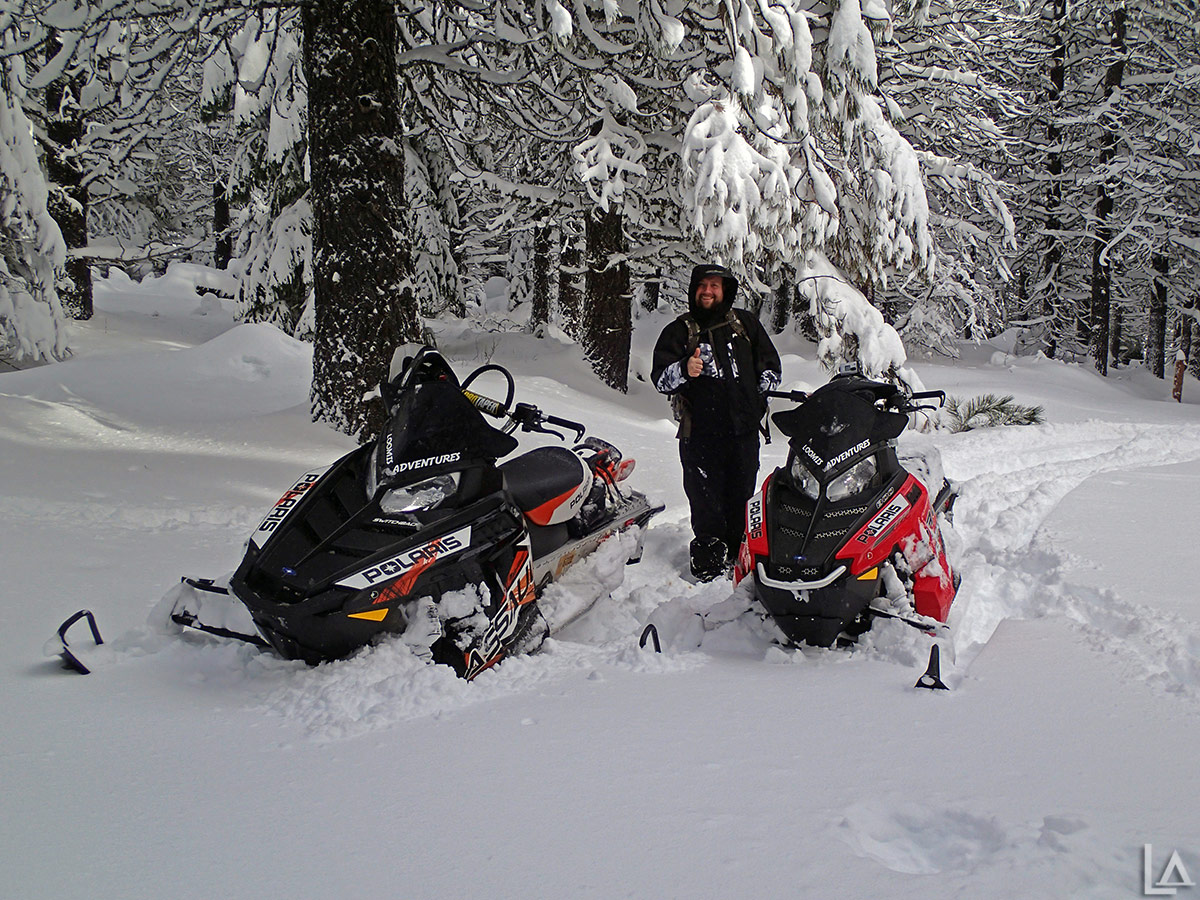 One last picture of John posing with my Polaris snowmobiles