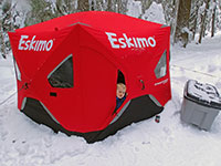 Julian peaking out of our Eskimo FatFish 6120I tent