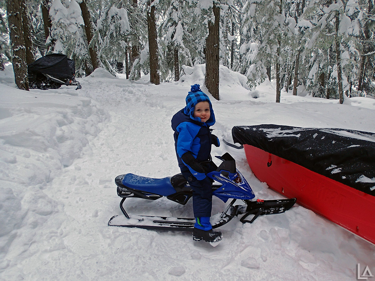 Julian playing on his snow sled