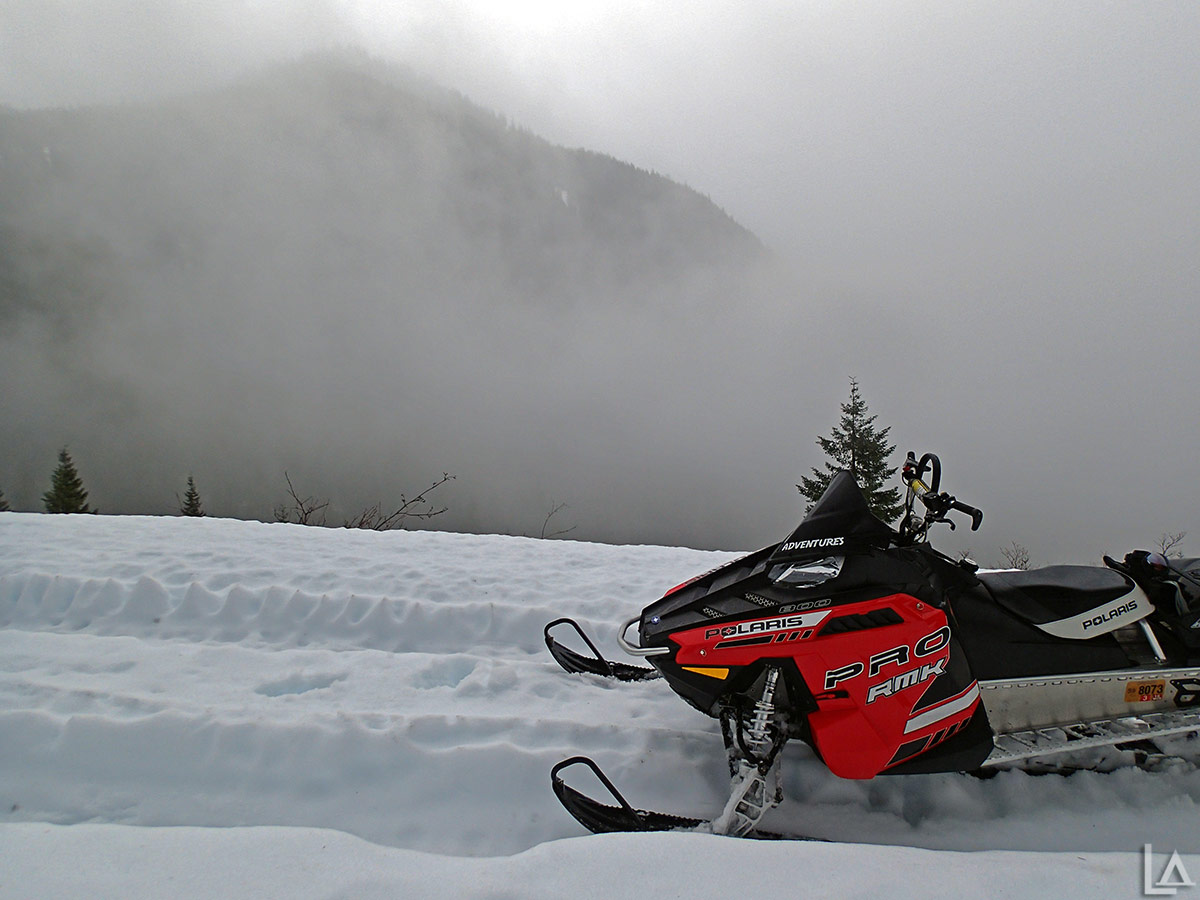 Rain and wet concrete snow make for terrible snowmobiling