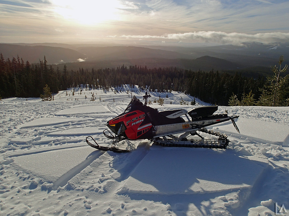 Snowmobile hill play on the back side of Frog Lake Buttes