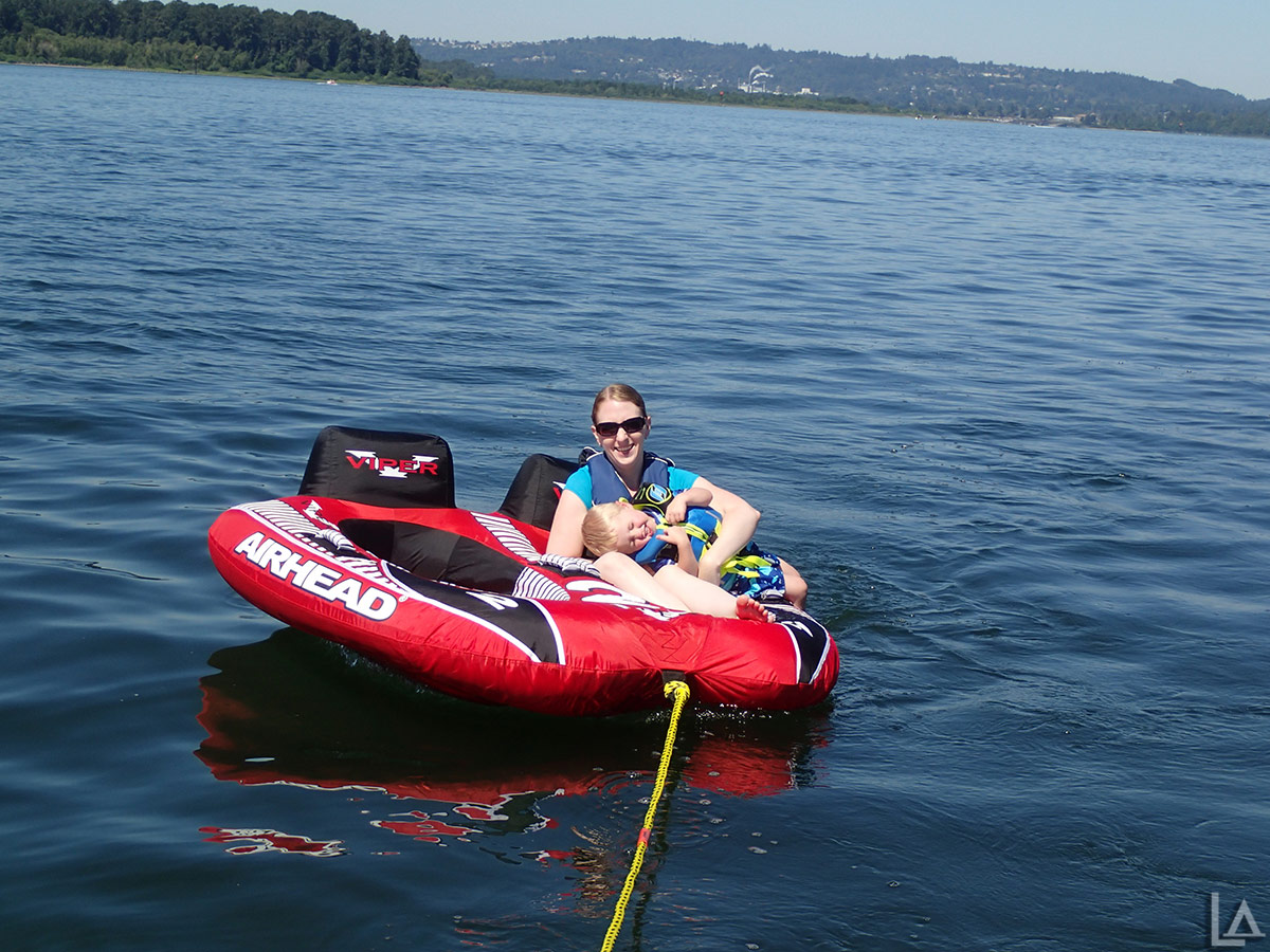 Katie and Julian tubing behind our boat