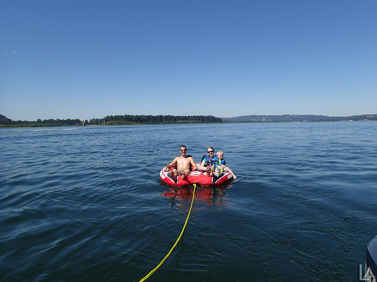 All three of us tubing behind our boat