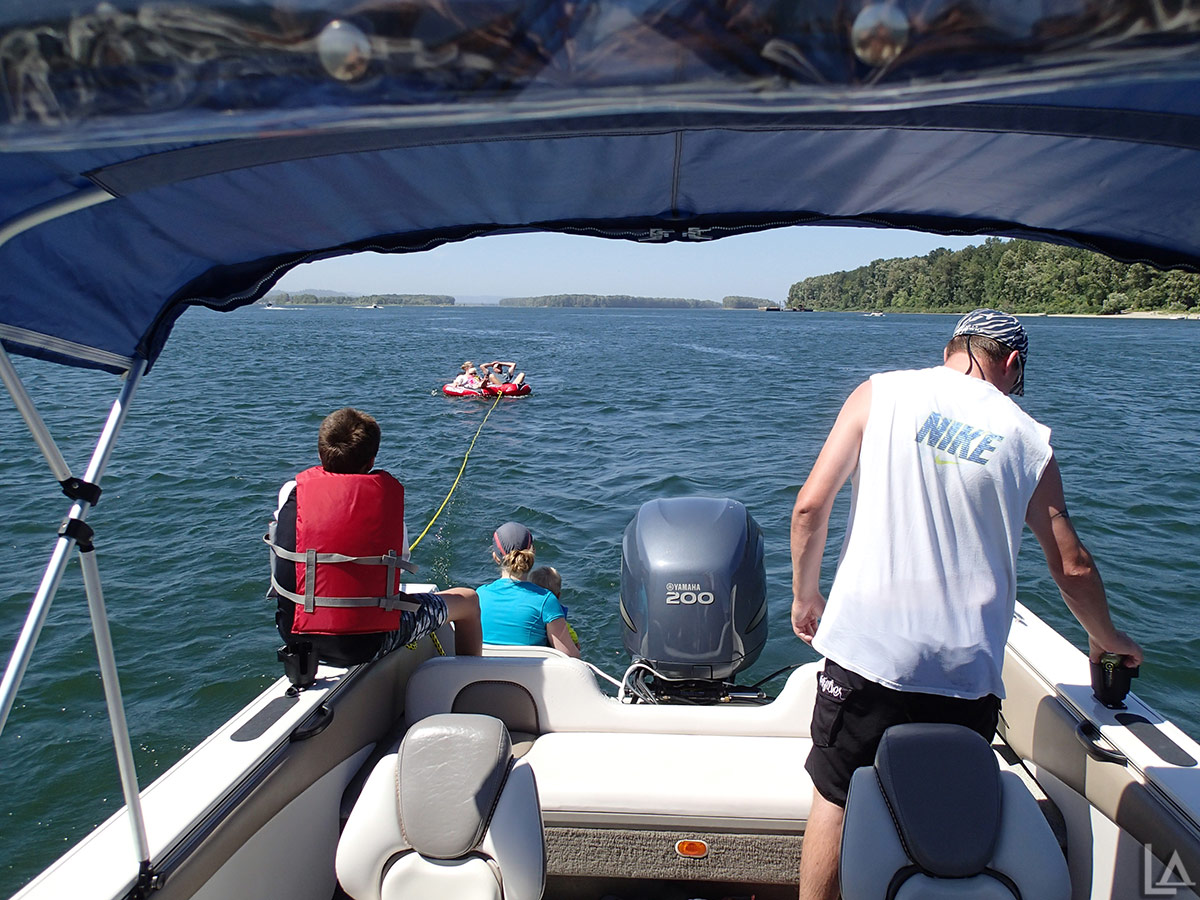 Jenny, Scott, and Brooklyn in the inner-tube
