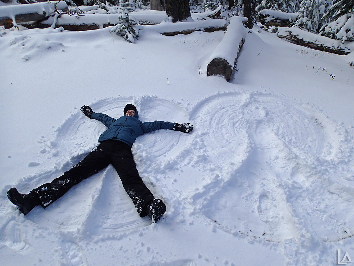 Katie making a snow angel next to mine