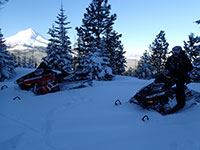 Snowmobiling with Mt Hood in the background