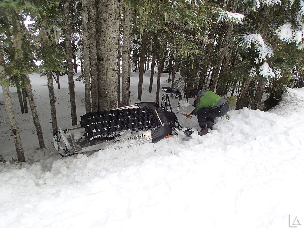 Rut roh - this sled is going to take some work to get back on the trail