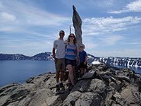 Family portrait with Crater Lake in the background