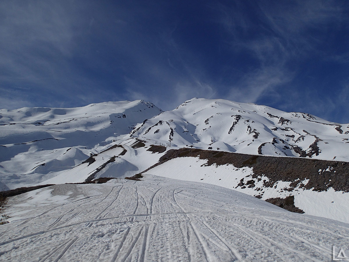 Snowmobiling up a ridge on Mt Saint Helens