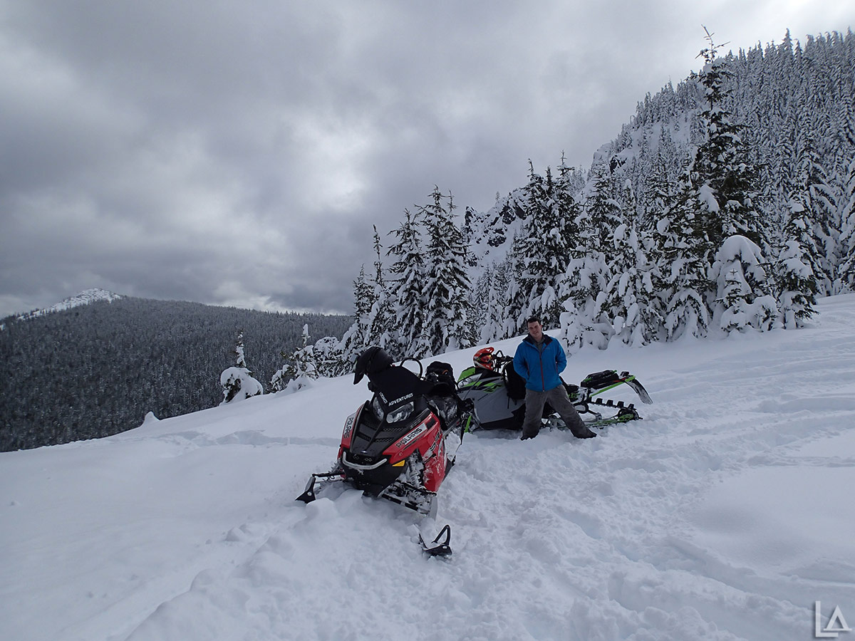 Snowmobiling at the base of High Rock