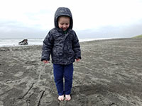 Julian at the beach with the Peter Iredale shipwreck in the background
