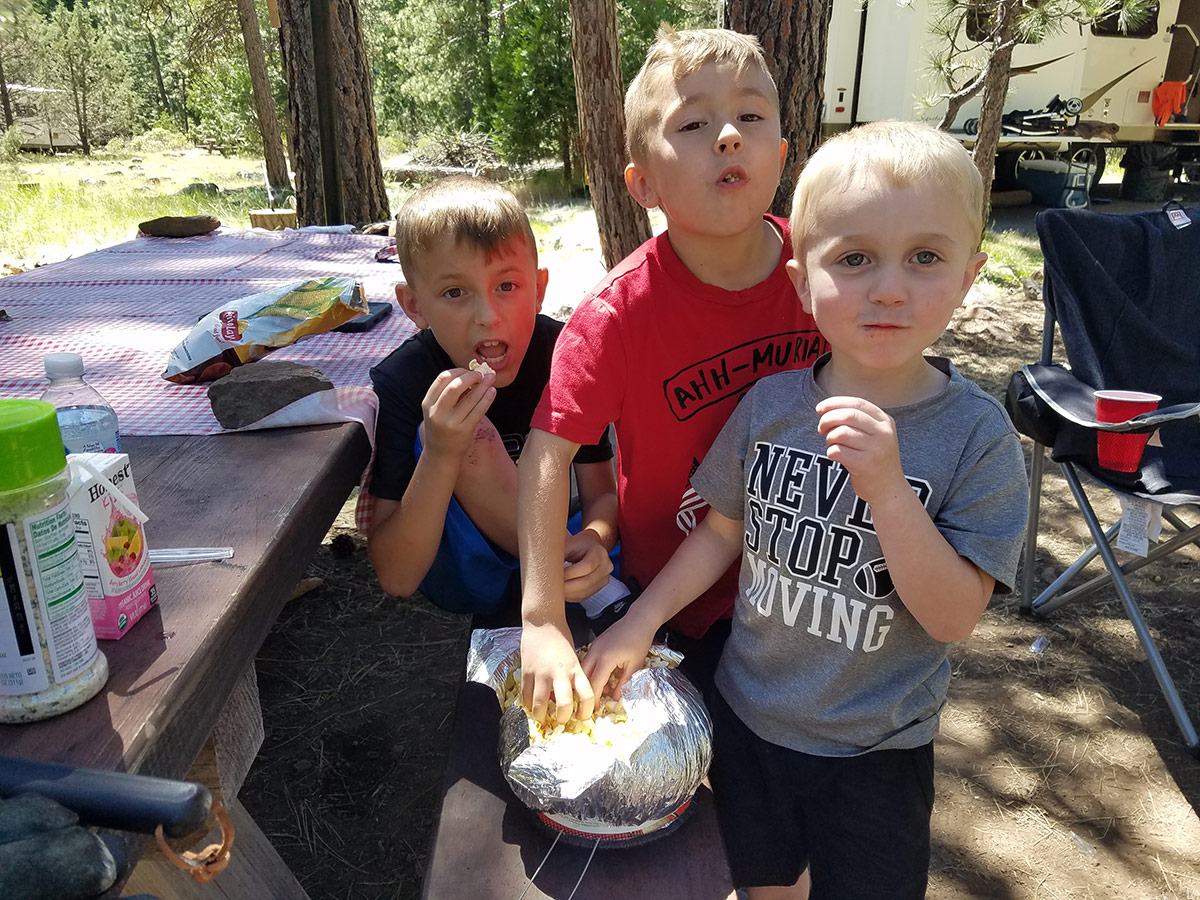 Dylan, Shane, and Julian gorging on popcorn